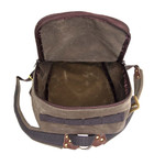 The box-style pack offers a spacious main compartment and cotton webbing attachment points on each external panel of the bag.