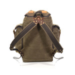 The padded sleeve is mounted to the bag by solid brass hardware to ensure that the straps will hold up.