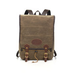 The Mesabi Range Daypack is made of premium leather, waxed canvas, and solid brass hardware. This product is made in Duluth, MN at Frost River.