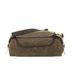A webbed cotton strap is included and the waxed canvas is water proof to ensure that your goods are transported safely.