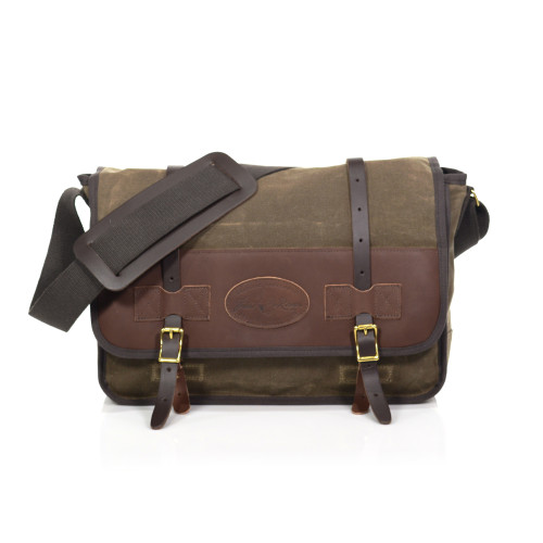 The Vintage Messenger Bag is made from premium leather, waxed canvas, webbed cotton, and solid brass hardware.