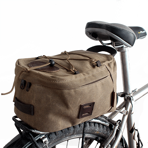 The Taconite Trail Bike Trunk is made of premium materials including waxed canvas, premium leather, and solid brass hardware.