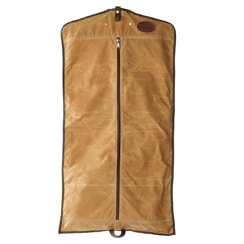 The Rollup Garment Cover is made of waxed canvas, premium leather, and solid brass hardware. There is hole on the top for a hanger to go through and a loop at the bottom to fold the garment bag in half.