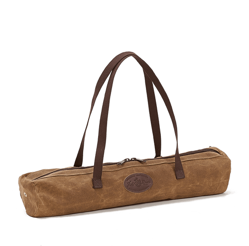 The Brewasana Yoga Mat Tote has long cotton shoulder straps and a large waxed canvas pocket that has a long zipper to make taking the mat out easy.