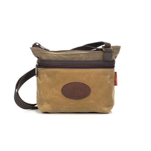 The Urban Field Bag is made in America at Frost River out of waxed canvas, solid brass hardware, and a cotton webbed strap.