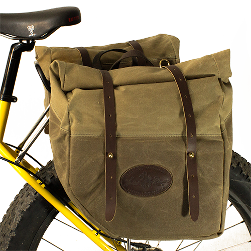The Highway 61 Panniers are made of waxed canvas, premium leather, and solid brass hardware. This unique product has a rolltop feature to allow for storage flexibility. This product is made in America at Frost River.