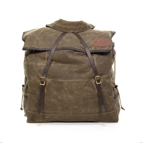 Grand Portage Canoe Pack No.759 is made in America and built to last. The long dark brown flap straps cross across the top of the pack to secure the folds creating the top closure.