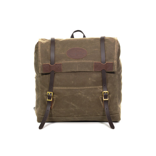 The Vintage Pack is crafted from waxed canvas, premium leather, and solid brass hardware.