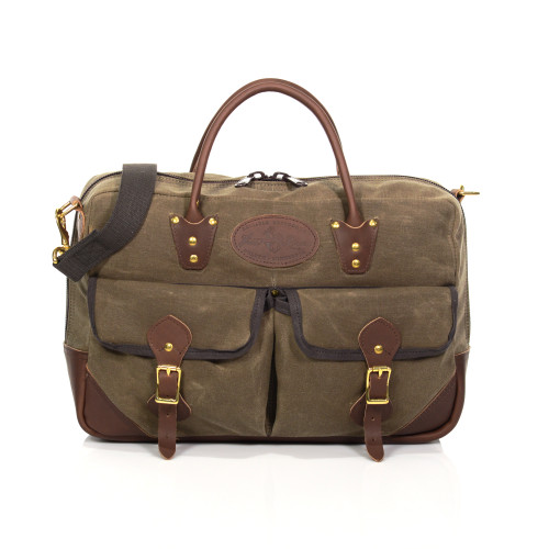 The Correspondent Brief is as reliable as it is sophisticated. A wide web cotton shoulder strap, leather carrying straps, waxed canvas, and solid brass hardware make this briefcase versatile and sturdy.