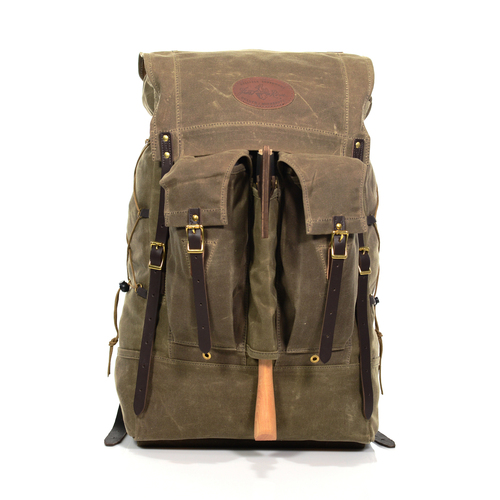 Isle Royale Bushcraft Pack No. 730. The largest Isle Pack of the collection. All Three offer buckskin padded backstraps, twin 2-in-1 exterior pockets, an axe sleeve, side compression cording, waxed canvas construction, and a guarantee to last.