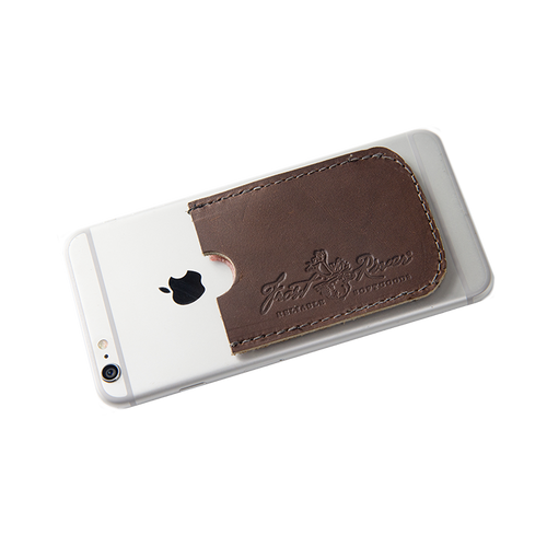 The Leather Card Caddy can attach to a phone, hard-drive, glove compartment, or tablet to keep your important cards handy.