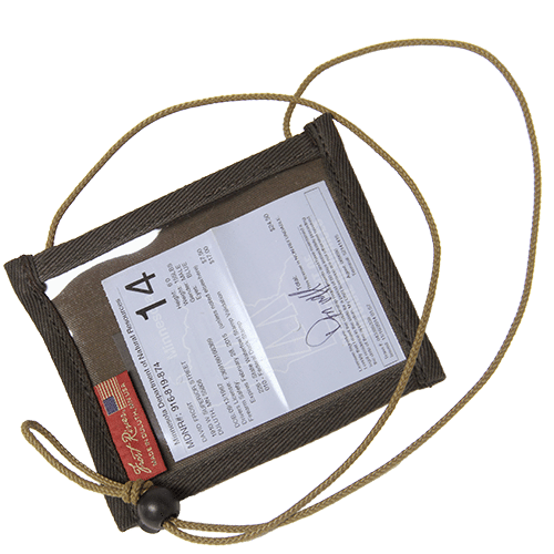 """The clear vinyl front, waxed canvas back pocket, and braided cord lanyard with barrel lock make this accessory great for an extra pocket for """"events"""", hunting and fishing."""