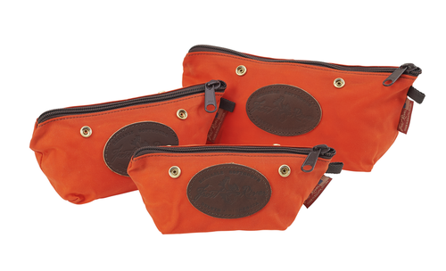 The Hunter Orange Accessory Bags with snaps by Frost River are available in three sizes. They are made of waxed canvas and durable zipper at Frost River in Duluth, MN. The snaps allow for the bags to be attached to each other or other Frost River items.