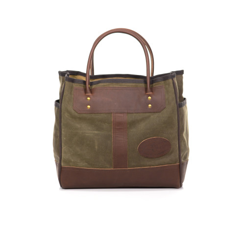 The Lake Superior Tote is crafted at Frost River with waxed canvas, premium leather, and solid brass hardware.