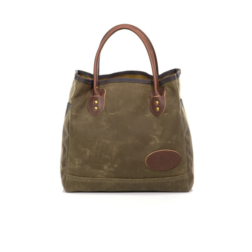 The Lake Michigan Tote is made of waxed canvas, premium leather, and solid brass hardware.