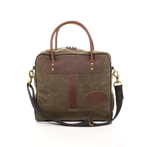 The Zippy Tote by Frost River is a cross between luggage, tote, and briefcase. This unique piece comes in two sizes and is made of premium materials including waxed canvas, leather, and solid brass hardware.