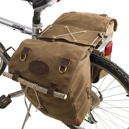 The Highway 1 Panniers are made of waxed canvas, premium leather, and solid brass hardware to ensure durability and quality.