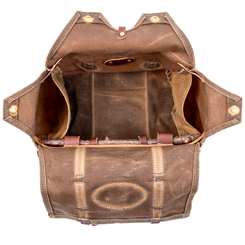 An inside view shows two side pockets and multiple flaps to keep your items inside the bag while going down the trails. There are also two D rings on the end that can attach a cotton webbed strap for cross-body use.