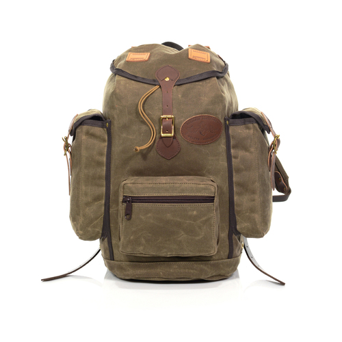 The Summit Expedition Pack is made from waxed canvas, premium leather, and solid brass hardware.
