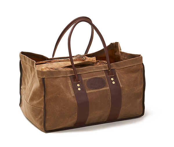Waxed canvas timber hauler tote bag with rolled leather handles.