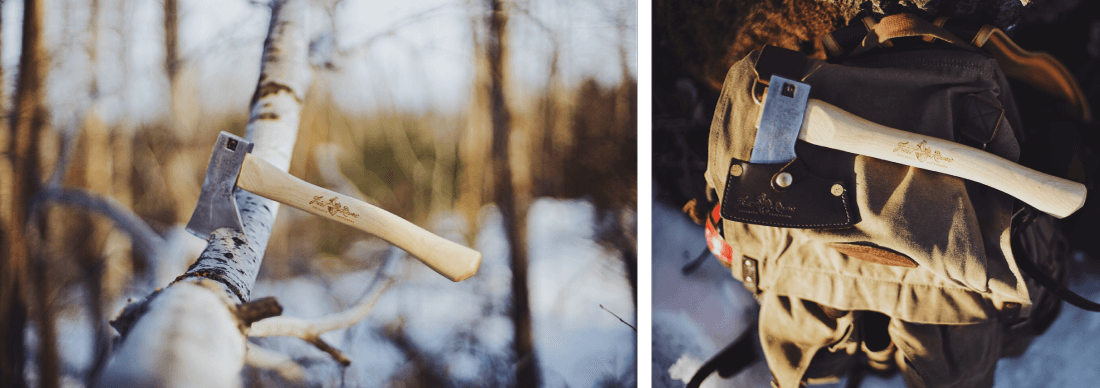 A hickory handled axe with a steel head adorned by Frost River's premium Boreal Axe Sheath.