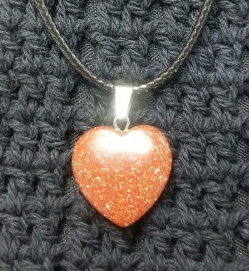 Heart Choker - Goldstone Brown 2 x 2cm Goldstone – Attracts money & power. Stimulates energy, healing, strength, emotional stability, creativity, joy & self-esteem. Assists in attaining goals, prosperity, magic. Releases fear of darkness. Protects again negative energies & bacteria.