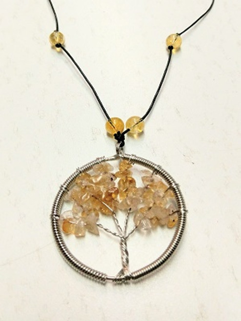 Tree of Life Necklace - Citrine Pendant measures 5cm in diameter & has citrine beads. It has adjustable leather band that can be also worn as a choker. Citrine is known as an abundance and prosperity stone. Place one in your wallet, cash box or wherever you keep your money. Citrine stimulates our creative energy, our will and increases our ability to bring energy into form. A stone to help manifest our dreams. Its sunny energy assists in bringing clarity to any situation. Aids in success, intuition, comfort, creativity, physical energy, wealth, mental awakening, protection, good fortune / luck, decrease nightmares, remove toxins.  Used for depression, mood swings, trauma, digestion, sleep disturbances, thyroid, general health, heart, kidney, liver, muscles, strength, endocrine & circulatory system, tissue regeneration, urinary system, immune system, fibromyalgia, addictions, ocd.
