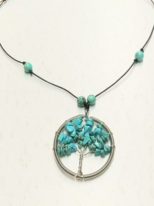 """Tree of Life Necklace - Turquiose Pendant measures 5cm in diameter & has citrine beads. It has adjustable leather band that can be also worn as a choker.  Turquoise - A beautiful gift from Mother Earth, Turquoise brings the blue of Father Sky to the Earth, blending together the energies of the heavens with the energies of the Earth. It is a healer of the spirit, providing a soothing energy which can bring peace and calm to the wearer. It is used by Native Americans as a protection stone. Spiritual attunement, cleansing, communication, healing, protection, soothing, peace of mind, guidance through the unknown, romantic spontaneity.  """"Master Healing Stone"""", prevents illness, bipolar disorder, panic disorder, all health issues in general."""