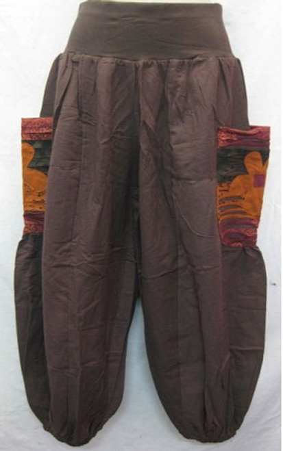 Winter Balloon Pant Brown Size L - up to 16/18 100% heavy cotton with stretch waist & elastic at ankles. Has orange flowered pockets at both sides.
