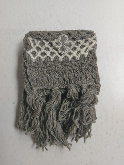 Knit Scarf Grey  100% pure wool Has tassles & crochet ends with a pretty crochet flower. Approx 20cm wide x 180cm long