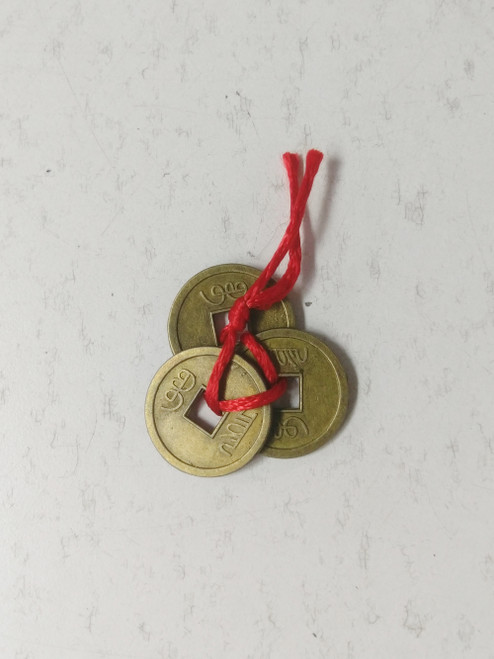 Feng Shui Good Luck Coins 3 3 brass Chinese coins held together with red rope. Is a good omen for creating wealth & bring in the good energy.  Approx 4cm x 4cm