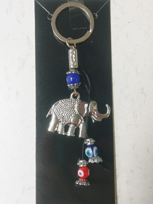 Blue Eye Elepant Keyring  The blue eye wards of evil & misfortune. The elephant symbolises strength, & attracts good luck.  Approx 13cm x 5cm