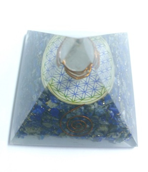 "Orgone Pyramid Lapis  ORGONITE refers to a mix of crystals and or semi-precious gemstones, metals and resin in a combination that may balance out our life-energy. This natural Earth energy is considered the most powerful energy there is and the frequency it resonates is considered the ""heartbeat"" of our planet.  The organic materials absorb the vital, orgonic energy, while the non-organic materials disperse it back in all directions.  Crystals & precious gemstones are electrically charged by the resin, that contracts them. Hence, the powerful healing effects of the crystals are magnified in an orgone pyramid.  Benefits of Orgone Pyramids:  When placed in your work, living or sleeping space, the orgone pyramids have the ability to clean the energies in the room & protect the individuals from EMF radiation. Laboratory research shows that living body cells strengthen their immunity & reach optimal physical & psychological health.  This includes:  Help insomnia & improve sleep & vivid & pleasant dreams  Improves immunity & resistance to illness, enhances energy & overall wellness  Protection from EMF radiation caused by electronic devices  Create a peaceful environment by enhancing positive energies  Access deeper meditative states, strengthen visualisations & intentions  Project high vibrational energies the minimise stress  Assists in imbalances as if they know what one needs on a spiritual level.  There are many Orgone Pyramids for many uses."