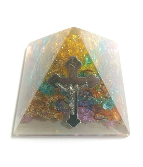 "Orgone Pyramid Chakra & Cross  ORGONITE refers to a mix of crystals and or semi-precious gemstones, metals and resin in a combination that may balance out our life-energy. This natural Earth energy is considered the most powerful energy there is and the frequency it resonates is considered the ""heartbeat"" of our planet.  The organic materials absorb the vital, orgonic energy, while the non-organic materials disperse it back in all directions.  Crystals & precious gemstones are electrically charged by the resin, that contracts them. Hence, the powerful healing effects of the crystals are magnified in an orgone pyramid.  Benefits of Orgone Pyramids:  When placed in your work, living or sleeping space, the orgone pyramids have the ability to clean the energies in the room & protect the individuals from EMF radiation. Laboratory research shows that living body cells strengthen their immunity & reach optimal physical & psychological health.  This includes:  Help insomnia & improve sleep & vivid & pleasant dreams  Improves immunity & resistance to illness, enhances energy & overall wellness  Protection from EMF radiation caused by electronic devices  Create a peaceful environment by enhancing positive energies  Access deeper meditative states, strengthen visualisations & intentions  Project high vibrational energies the minimise stress  Assists in imbalances as if they know what one needs on a spiritual level.  There are many Orgone Pyramids for many uses."