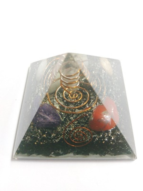 "Orgone Pyramid Touraline  ORGONITE refers to a mix of crystals and or semi-precious gemstones, metals and resin in a combination that may balance out our life-energy. This natural Earth energy is considered the most powerful energy there is and the frequency it resonates is considered the ""heartbeat"" of our planet.  The organic materials absorb the vital, orgonic energy, while the non-organic materials disperse it back in all directions.  Crystals & precious gemstones are electrically charged by the resin, that contracts them. Hence, the powerful healing effects of the crystals are magnified in an orgone pyramid.  Benefits of Orgone Pyramids:  When placed in your work, living or sleeping space, the orgone pyramids have the ability to clean the energies in the room & protect the individuals from EMF radiation. Laboratory research shows that living body cells strengthen their immunity & reach optimal physical & psychological health.  This includes:  Help insomnia & improve sleep & vivid & pleasant dreams  Improves immunity & resistance to illness, enhances energy & overall wellness  Protection from EMF radiation caused by electronic devices  Create a peaceful environment by enhancing positive energies  Access deeper meditative states, strengthen visualisations & intentions  Project high vibrational energies the minimise stress  Assists in imbalances as if they know what one needs on a spiritual level.  There are many Orgone Pyramids for many uses."