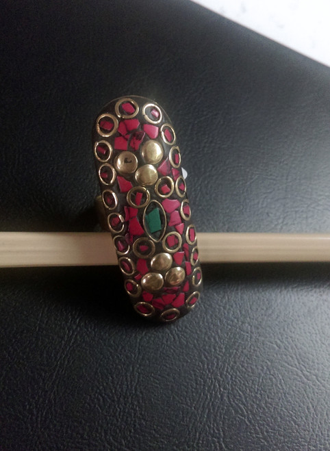 Tibetan Red Coral Ringwith green torquoiseinserts. This lovely ring is set in brass & has an adjustable band.