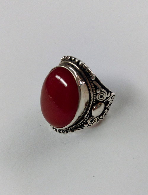 Beautiful dark orang/red large carnelian gemstone ring. It is set in sterling silver. Approx 2.8cm long x 2cm wide. Size 7