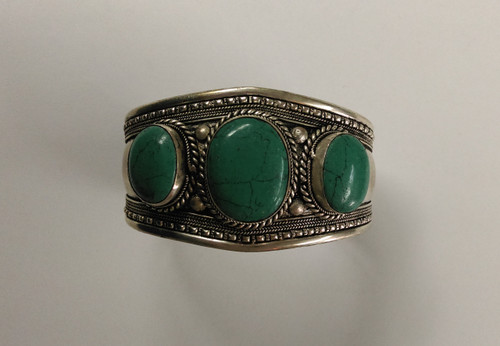 Tibetan Silver Bangle with 3 large turquoise gemstones. Approx 4cm wide.