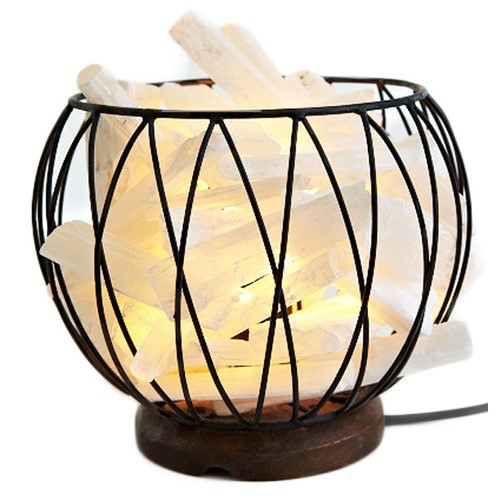 Selenite Caged Lamp  Selenite 'Stalagmite' Caged Fire Bowl Comes with cord & Globe Selenite is a calm stone that In stills deep peace and is excellent for meditation or spiritual work. Selenite is a type of gypsum crystal that is often translucent or a shimmering opaque. Our selenite products come from the ancient sea beds in Morocco. The purest translucent white selenite is said to have an ethereal quality, inhabiting the space between light and matter. The very fine vibration of selenite brings clarity of mind. Its high frequency vibration qualities link it to the light body, helping to anchor it to the earths vibrations. This versatile and often underrated crystal has properties that make it truly unique for spiritual and metaphysical purposes