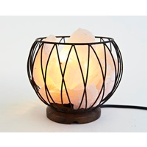 Clear Quartz Cage Lamp  Comes complete with cord & bulb The Ultimate Unblocker and Deep Soul Cleanser. The Most dominate, versatile multi-purpose healing stone, especially in cases of low self-esteem and healing wounds. It promotes decisiveness and reinforces clarity. Suggested Placement: Do not place anywhere in the home where you sleep as it is and active crystal