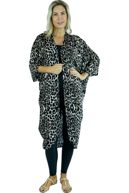 SD Long Cape Leopard Dark. The Long Cape is draped loosely due to the soft cool nature of the rayon fabric.This will make a gorgeous addition to any simple outfit. A definite must have for this summer! ONE SIZE TO FIT SIZE 10-18