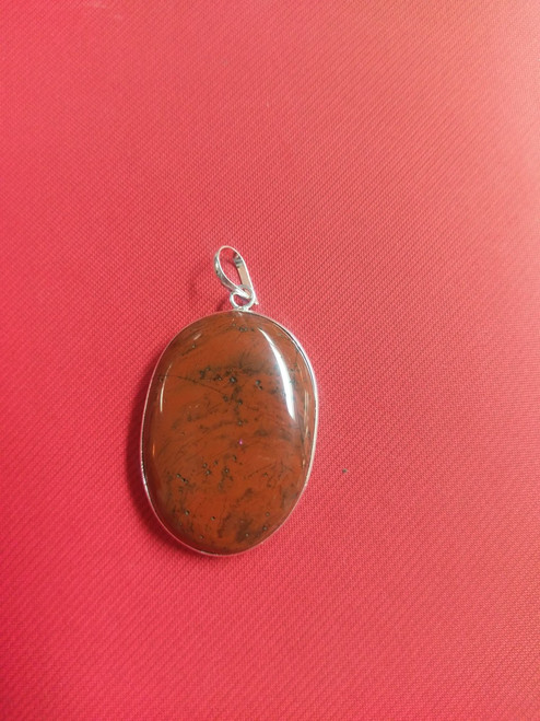 Red Jasper Pendant. Assorted Oval shaped Pendants wrapped in silver plate. All pendants range in size, colour & markings. They range from approximately 2.75cm x 4cm. Can be wider or shorter. All pendants are wrapped in silver metal with a bail.