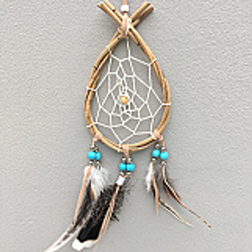 Teardrop Dreamcatcher Small. Has brown featherw with blue, silver & white beads. Made from natural cane. Approx 11cm x 48cm.