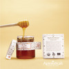 It has truly unique characteristic metallic highlights across its dark red color. That's right - this honey is so rich that it's dark red. Its richness is also textural: it is extremely thick.