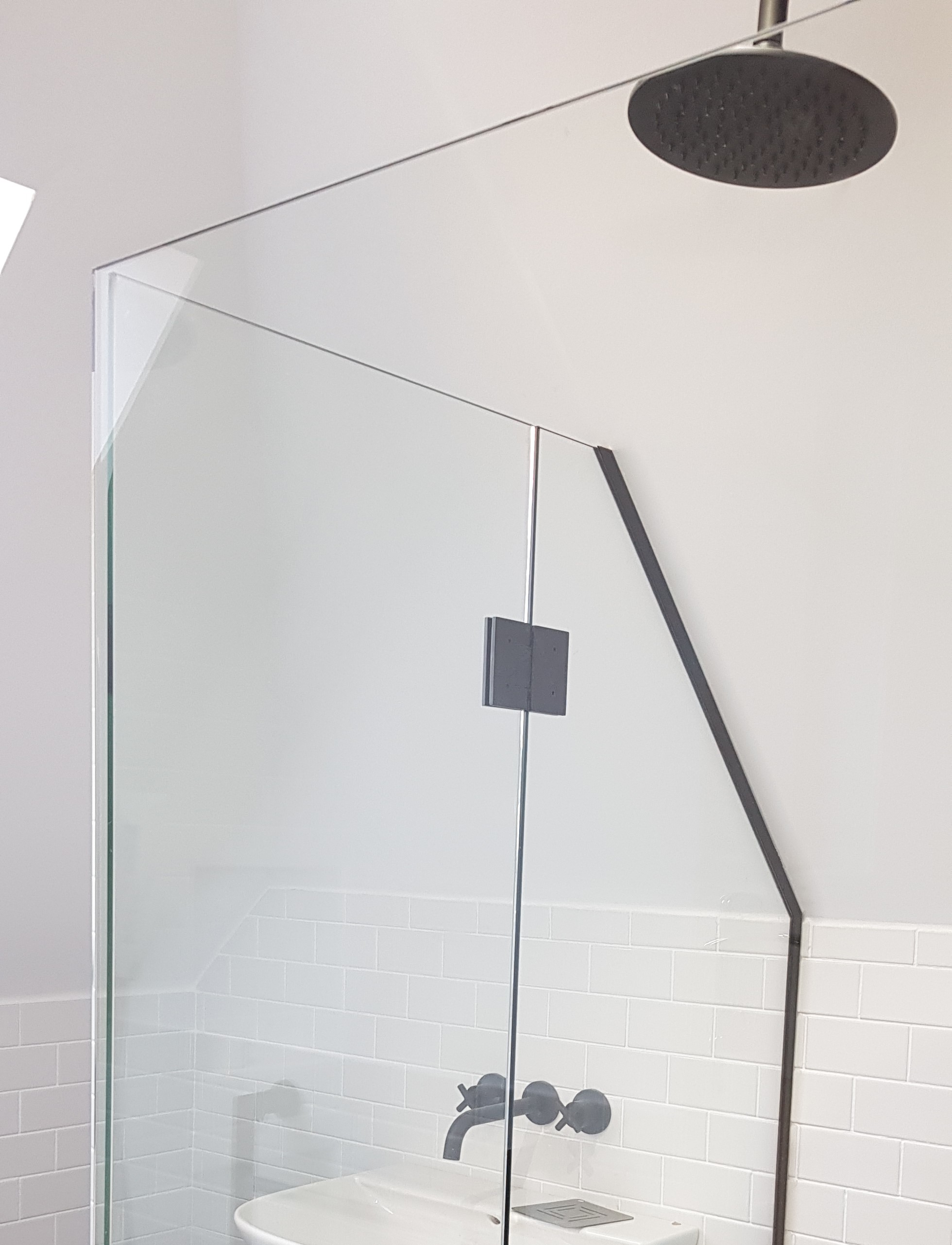 Shower screen enclosure in attic
