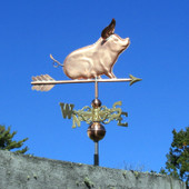 Sitting Pig Weathervane with floppy ears, right side view on blue sky background