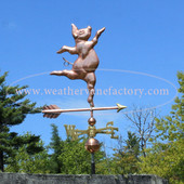 Dancing Pig Weathervane right side view on blue sky background