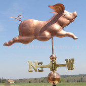 Running Pig Weathervane right side view on blue sky background