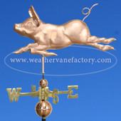 Running Pig Weathervane sporting a huge smile weathervane, left side view on blue sky background.