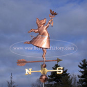 dancing pig with flower weathervane right side view on stormy sky background